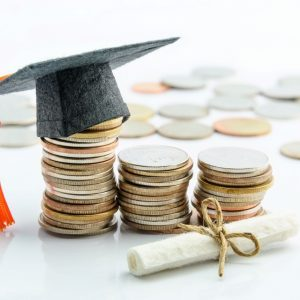 Photo of graduation hat and money