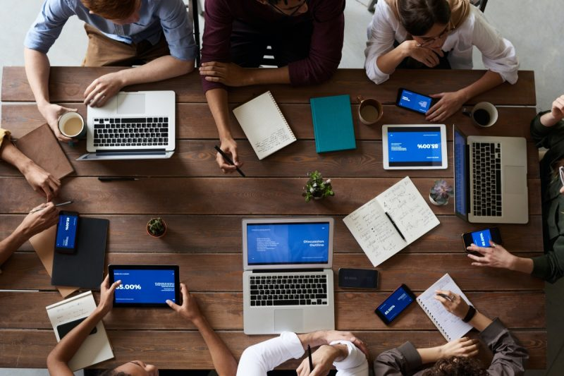 Photo of people looking at laptops